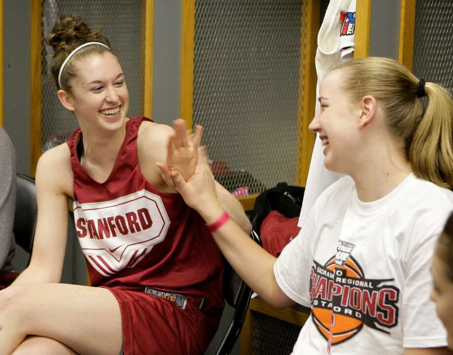 Stanford's Hannah Donaghe, left, and Mikaela Ruef hi-five each other as they talk in the locker room before the start of a closed practice at the NCAA Women's Final Four college basketball tournament Monday, April 5, 2010, in San Antonio, Texas. Stanford plays Connecticut for the national championship Tuesday night. Photo: Sue Ogrocki