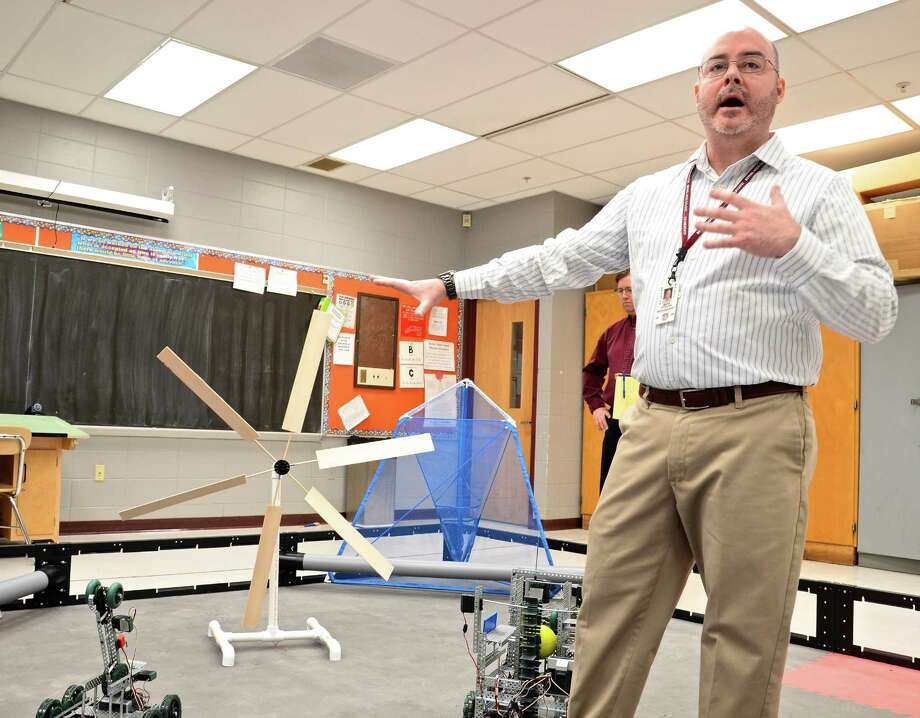 Mark Doolan, chairman of the Applied Studies Department at Bethel High School, talks about a wind mill prototype that a student recently designed and built as part of a senior project. On Friday, Jan. 29, 2016, two students showcased their projects to members of the Business Advisory Council, a partnership between the school and representatives from local businesses and colleges. Photo: Nelson Oliveira / Hearst Connecticut Media / The News-Times