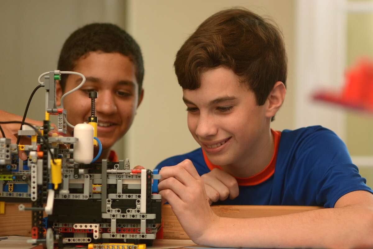 The Rubicon Academy Robotics team includes Kabir Jolly, 13, from left, an 8th grader at The John Cooper School, and Brant DeGroot, 13, a 7th grader at McCullough Jr. High. (Photo by Jerry Baker/Freelance)