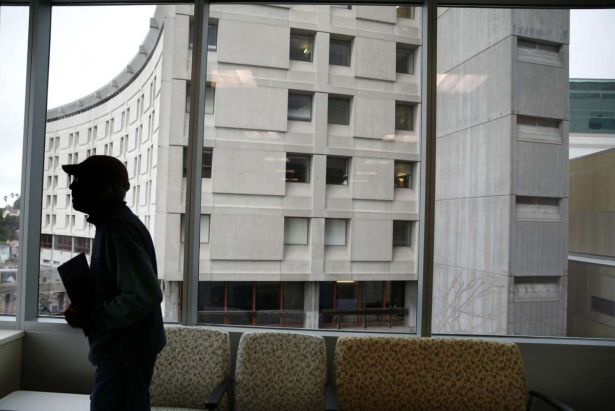 A guest touring the new Acute Care Tower visits a family waiting room in front of the soon-to-be demolished original 1968 building at Highland Hospital in Oakland, Calif. on Friday, Jan. 29, 2016.