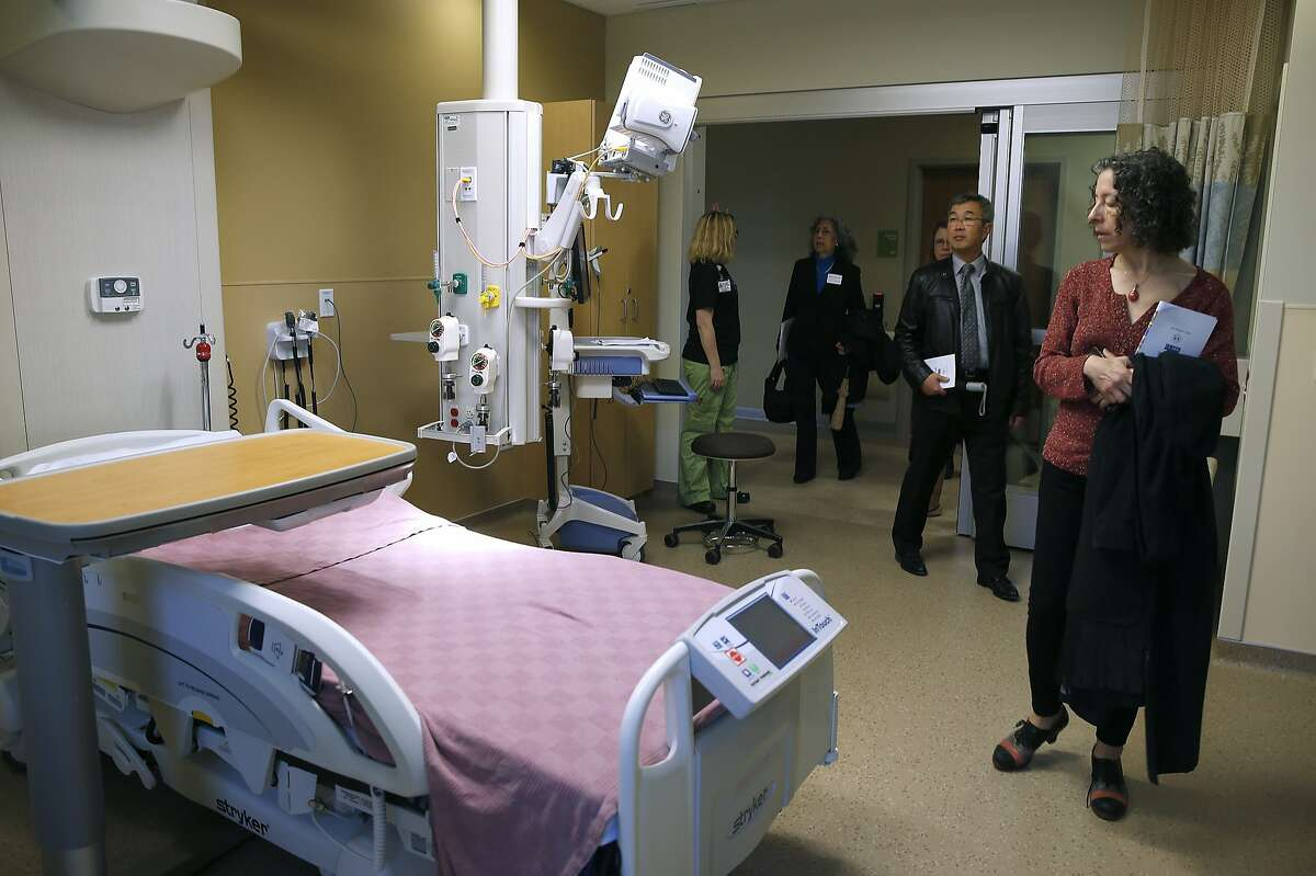 Linda Katz (right) tours the intensive care unit on the 5th floor of the new Acute Care Tower at Highland Hospital in Oakland, Calif. on Friday, Jan. 29, 2016.