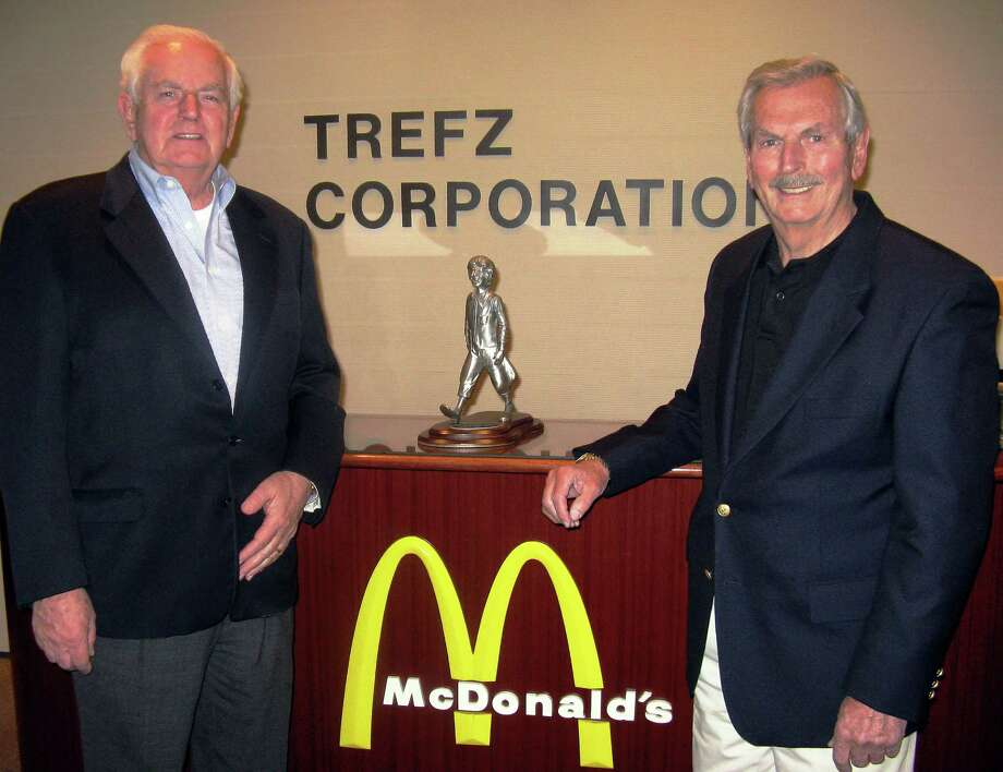 Chris, left, and Ernie Trefz receiving the Golden Arch Award in April at McDonald's Worldwide Convention in Florida. The McDonald's on Main Street in Bridgeport, owned by the Trefz Corp., is closing its doors. Photo: Contributed Photo / Connecticut Post Contributed