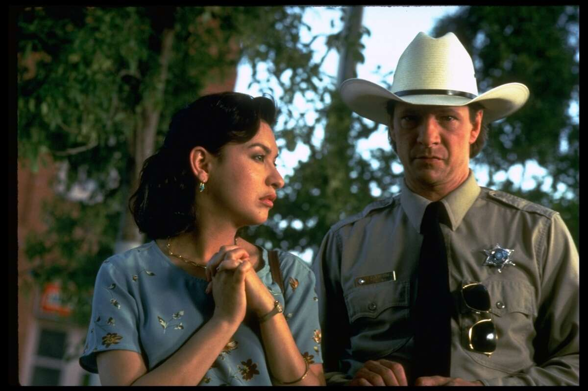 """Lone Star: This was by far the number one movie readers recommended watching to understand Texas. Written and directed by John Sayles it stars Kris Kristofferson, Matthew McConaughey, Chris Cooper and Elizabeth Peña. """"Lone Star really captures Texas as it is lived by normal folk. The Dallas Cowboy's fan played by Frances McCormand was great, the """"bribes or bullets"""" sheriff, the young ones trying to live in it today ... go see it now!"""" -- ccbbb23"""