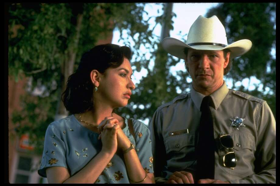 """Lone Star:This was by far the number one movie readers recommended watching to understand Texas. Written and directed by John Sayles it stars Kris Kristofferson, Matthew McConaughey, Chris Cooper and Elizabeth Peña.""""Lone Star really captures Texas as it is lived by normal folk. The Dallas Cowboy's fan played by Frances McCormand was great, the """"bribes or bullets"""" sheriff, the young ones trying to live in it today ... go see it now!"""" -- ccbbb23 Photo: Alan Pappe, The LIFE Images Collection/Getty"""