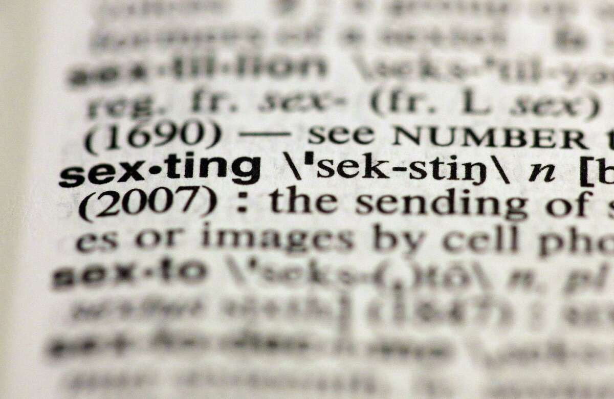 """The entry """"sexting,"""" photographed in New York, Friday, Aug. 10, 2012, is one of the 15 new additions in the 11th edition of Merriam-Webster's Collegiate Dictionary. (AP Photo/Richard Drew)"""