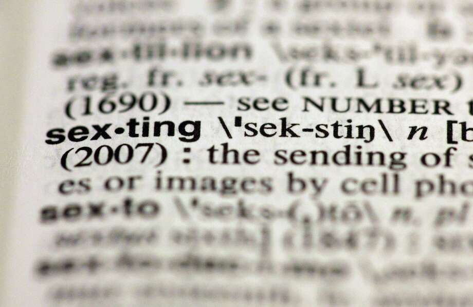 "The entry ""sexting,"" photographed in New York, Friday, Aug. 10, 2012, is one of the 15 new additions in the 11th edition of Merriam-Webster's Collegiate Dictionary. (AP Photo/Richard Drew) Photo: Richard Drew / Associated Press / AP"