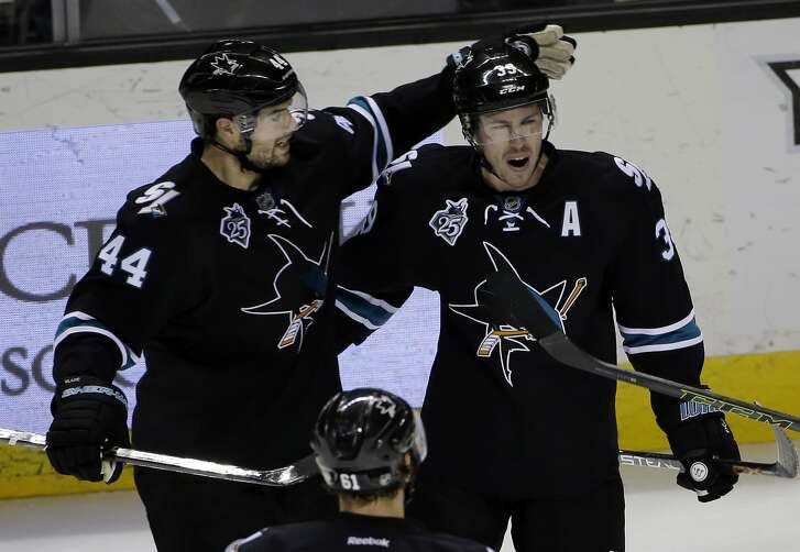 San Jose Sharks center Logan Couture, right, celebrates a goal with teammate Marc-Edouard Vlasic during the third period of an NHL hockey game Sunday, Jan. 24, 2016, in San Jose, Calif. Los Angeles won 3-2. (AP Photo/Marcio Jose Sanchez)