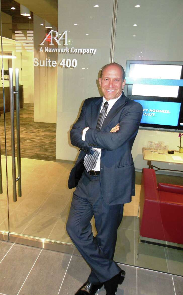 Howard Lutnick visited Newmark Grubb Knight Frank's Houston office in BLVD Place on Tuesday, Jan. 25. Lutnick is chairman and CEO of BGC Partners, the parent company of NGKF, and chairman and CEO of Cantor Fitzgerald.