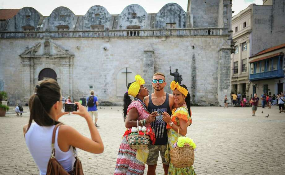 U.S. citizens can travel to Cuba, but not as tourists. Visitors must be traveling under one of 12 approved catagories. Photo: YAMIL LAGE, Stringer / AFP