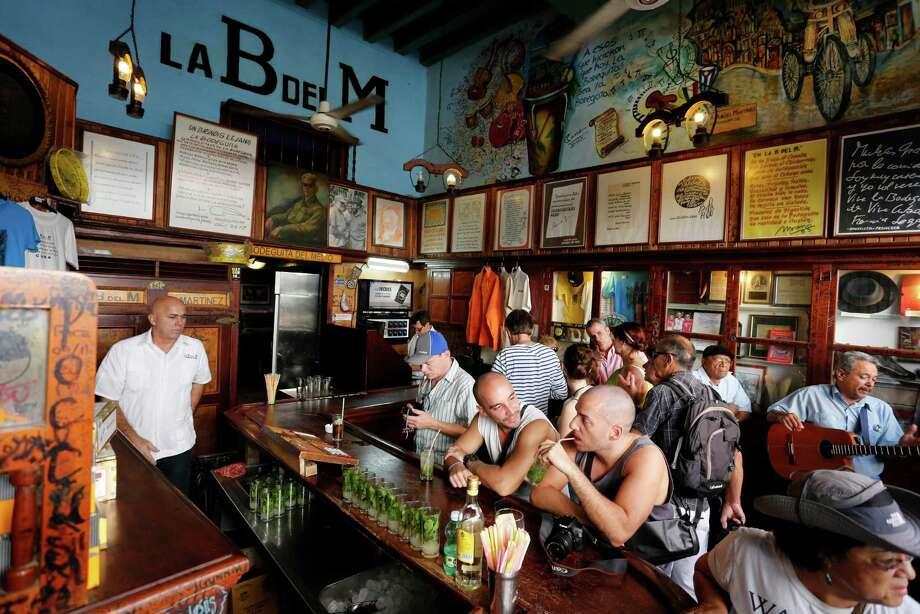 Tourists fill La Bodeguita del Medio, the Old Havana bar where Ernest Hemingway used to drink. Photo: Desmond Boylan, AP / AP