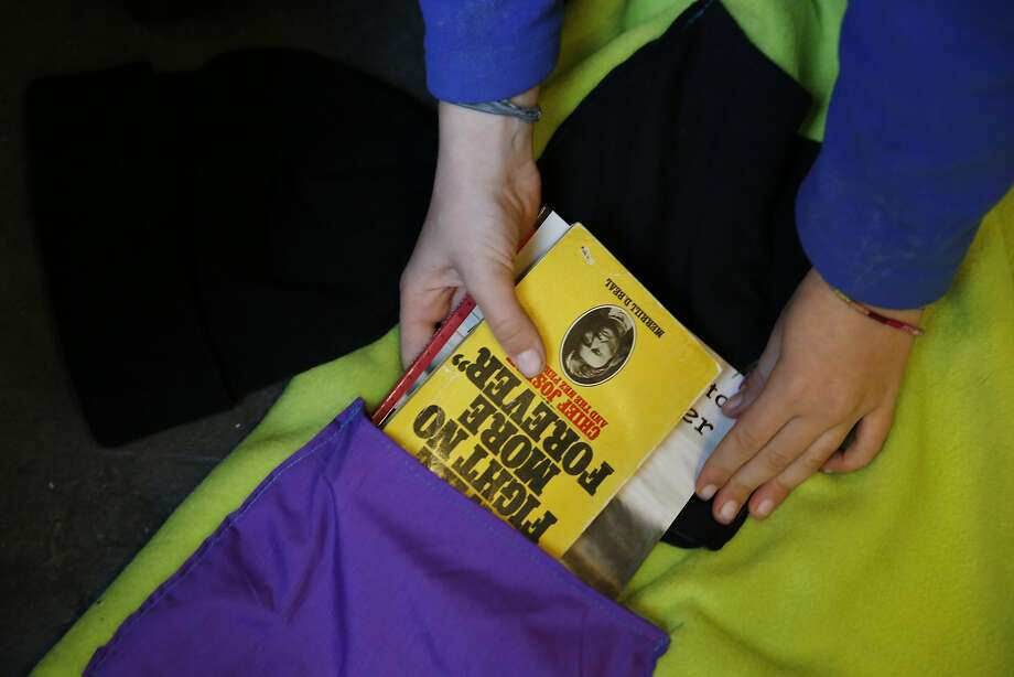 Vivian Blantz, 10,  fills an Undercover blanket pocket with books at Alley Cat Books before handing them out to homeless residents on Friday, January 29, 2016 in San Francisco, Calif. Photo: Lea Suzuki, The Chronicle
