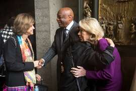 Charlotte Mailliard Shultz and Willie Brown, second from left, say goodbye to guests following a memorial service for Wilkes Bashford, Friday, Jan. 29, 2016, at Grace Cathedral in San Francisco, Calif. Bashford was a luxury clothier and philanthropist.