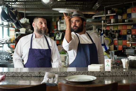 Chef/owners (l to r) Assaf Granit and Uri Navon helm the hottest restaurant in Israel, Jerusalem's Machneyuda. (Photo by Curtis Ellis)