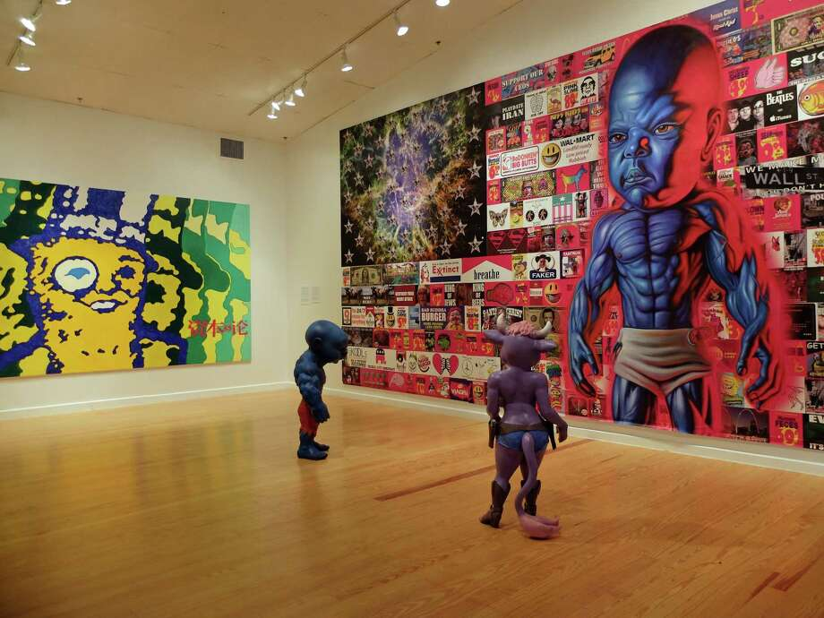 """A painting based on Mr. Peanut, by Clark Fox, above, and works by Ron English subvert iconic marketing imagery. Eugenio Merino's """"Always"""" sculptures, left, feature a rogue's gallery of world leaders. Photo: Molly Glentzer"""