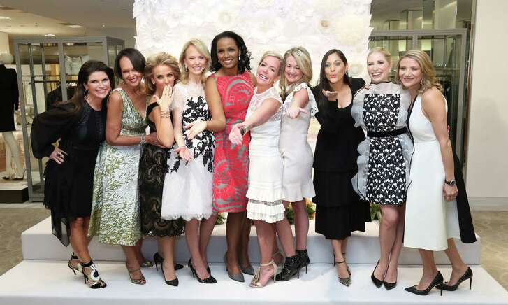 The 2016 Houston Chronicle Best Dressed honorees are, from left, Laura Davenport, Gayla Gardner, Mary Tere Perusquia, Susan Sarofim, Winell Herron, Rosemary Schatzman, Millette Sherman, Sippi Khurana, Isabel David and Stephanie Cockrell. They gathered for a photo at the announcement party at Neiman Marcus in the Galleria.