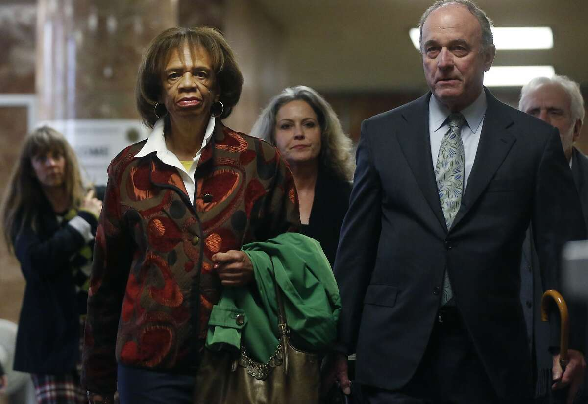 Zula Jones, left, walks to a court room with her attorney John Keker Jan. 29, 2016 for an appearance in Superior Court for charges of accepting bribes for political favors in the Hall of Justice Building in San Francisco, Calif.