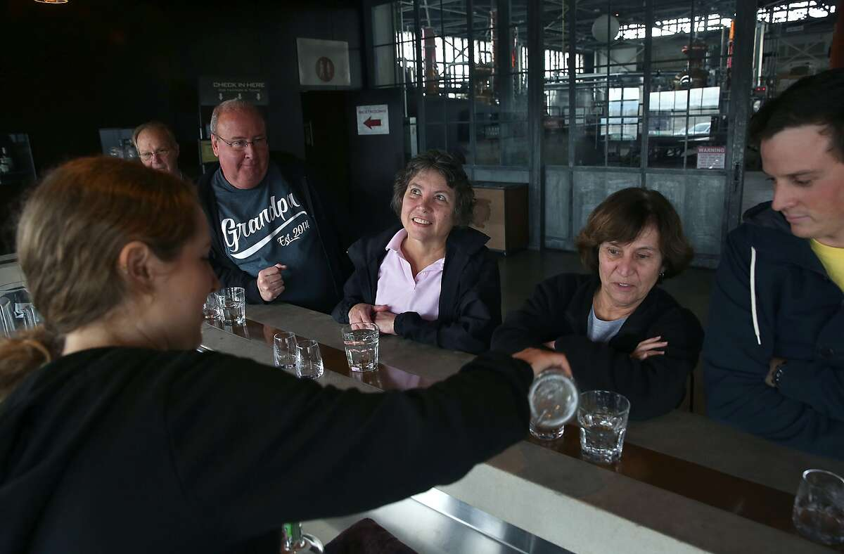 Mark Donohue and Kathy Donohue (left) from Oakland, Jo Ann Cabral (middle) from Massachusetts and Acer Gossett (right) from Phoenix in the tasting room at St. George Spirits in Alameda, California, on Thursday, January 28, 2016.