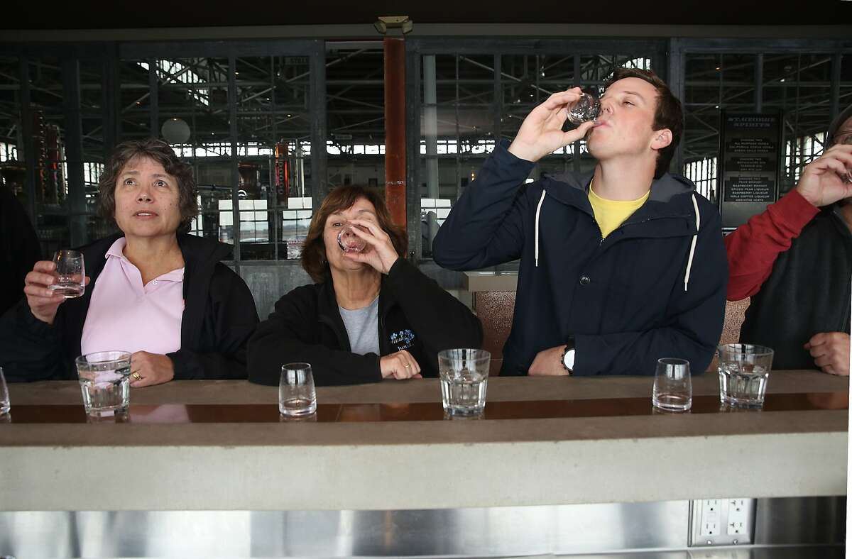 Kathy Donohue (left) from Oakland, Jo Ann Cabral (middle) from Massachusetts and Acer Gossett (right) from Phoenix try spirits in the tasting room at St. George Spirits in Alameda, California, on Thursday, January 28, 2016.