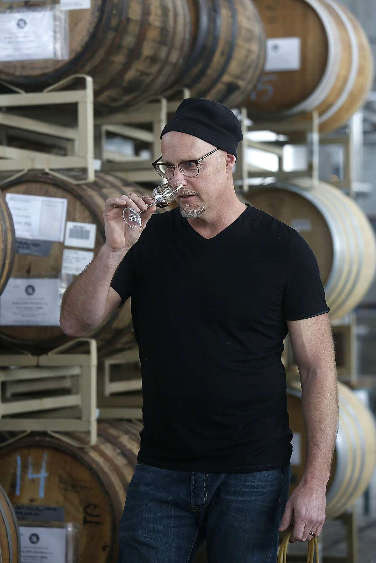 Master distiller Lance Winters checks a few spirits in barrels at St. George Spirits in Alameda, California, on Thursday, January 28, 2016.