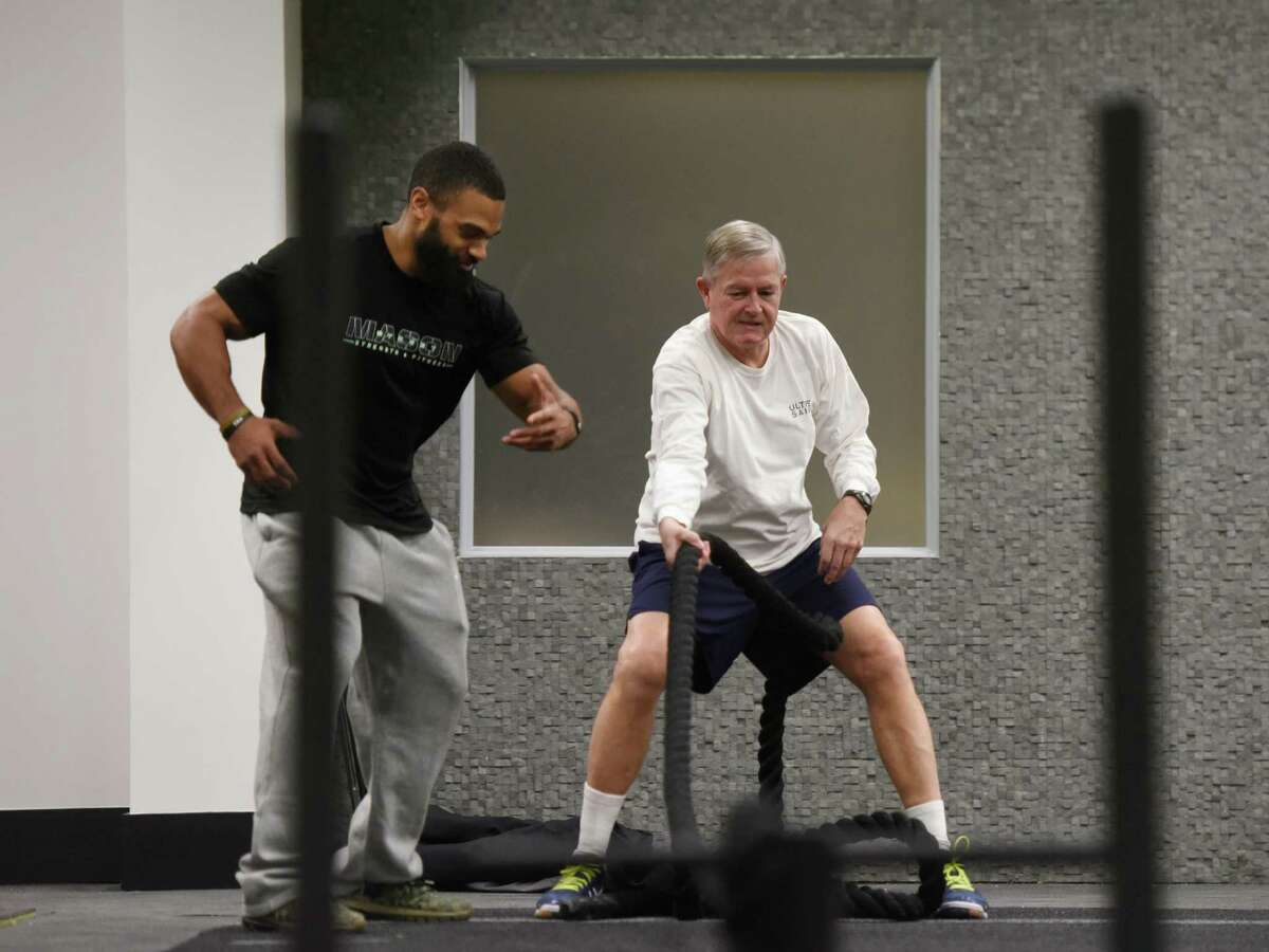 Greenwich resident Bill Schneider, right, trains with strength coach Shawn Harris at Mason Street Strength and Fitness in Greenwich, Conn. Wednesday, Jan. 27, 2016. The gym opened earlier this month under the leadership of three friends and features personalized workouts from strength coaches as well as yoga and TRX.