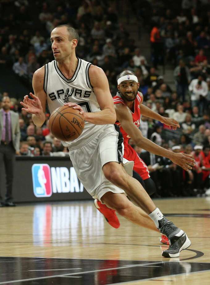 San Antonio Spurs' Manu Ginobili drives past Houston Rockets' Corey Brewer during the first half at the AT&T Center, Wednesday, Jan. 27, 2016. Photo: San Antonio Express-News / © 2016 San Antonio Express-News