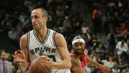 San Antonio Spurs' Manu Ginobili drives past Houston Rockets' Corey Brewer during the first half at the AT&T Center, Wednesday, Jan. 27, 2016.