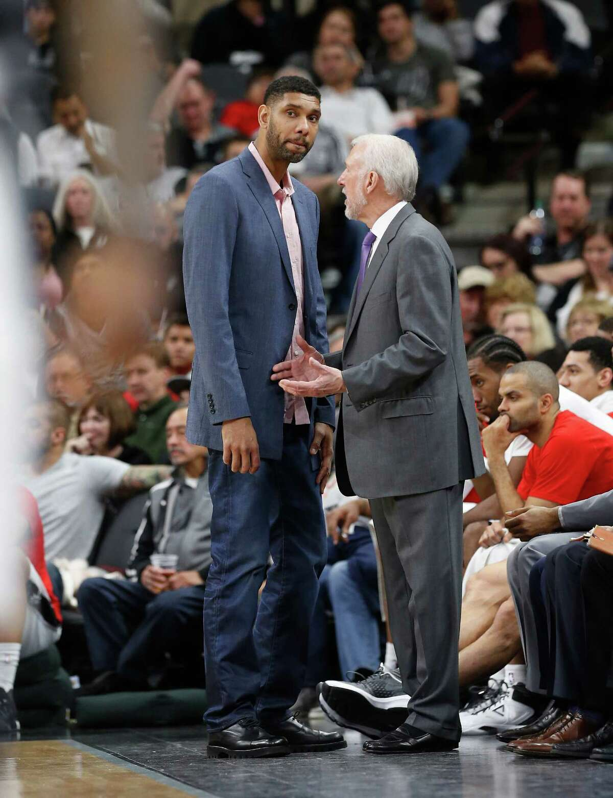 Spurs' Tim Duncan (left) and Spurs head coach Gregg Popovich chat during the game against the Houston Rockets at the AT&T Center on Wednesday, Jan. 27, 2016. Spurs defeated the Rockets, 130-99. Duncan rested due to a sore knee. (Kin Man Hui/San Antonio Express-News)