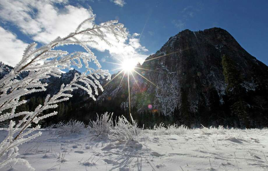 The Cathedral Rocks are a dark contrast to the snowy meadow in Yosemite Valley in Yosemite National Park, Calif., on Dec. 30, 2015. Photo: Laura A. Oda /McClatchy-Tribune News Service / Oakland Tribune