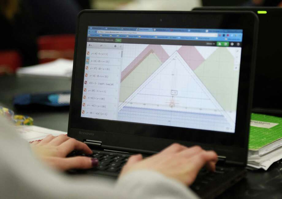 "A student writes equations to plot lines on a graph for a project in the Innovation Lab at Greenwich High School. The Innovation Lab is one of the sponsors of a screening of ""Most Likely to Succeed"" at GHS on Monday. Photo: Tyler Sizemore / File Photo / Greenwich Time"