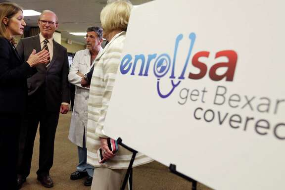 U.S. Department of Health and Human Services Secretary Sylvia M. Burwell (from left), and Bexar County Judge Nelson Wolff talk with Dr. Abraham A. Alecozay and others as they tour a health insurance enrollment event Friday Jan. 29, 2016 at Southwest General Hospital.