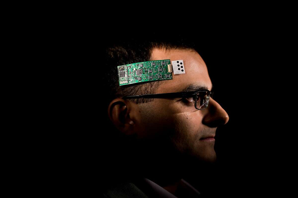 Ali Javey models a wearable sweat sensor on at UC Berkeley on Friday, Jan. 29, 2016, in Berkeley. The sensor can track molecular body chemistry like sodium, glucose, potassium and lactate levels and transmit the data wirelessly to a smartphone.