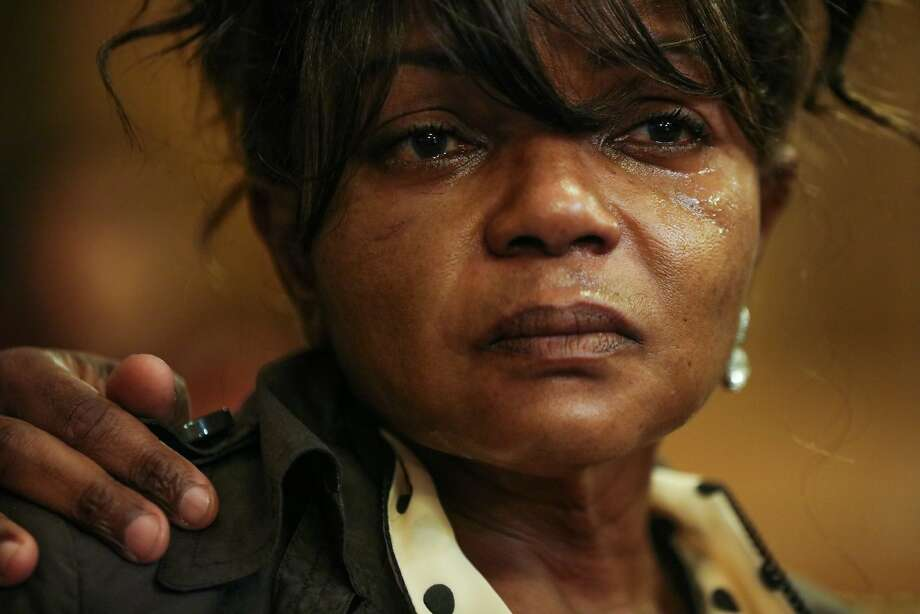 Paulette Brown, whose 17-year old son was gunned down in 2006, sits tearfully during a Board of Supervisors meeting. Photo: Gabrielle Lurie, Special To The Chronicle