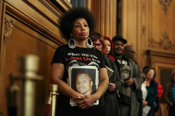 Mattie Scott (center), waits in line to speak in front of the Board of Supervisors at City Hall in San Francisco, California on Tuesday, January 12, 2016. Mattie Scott advocates for better gun control as her son was murdered in 1996 due to gun violence.