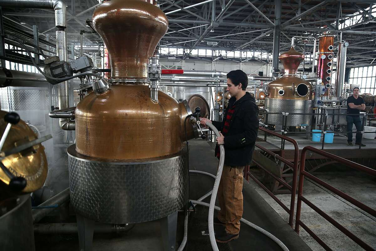 Assistant distiller Christopher Jordan cleans a still at St. George Spirits in Alameda, California, on Thursday, January 28, 2016.