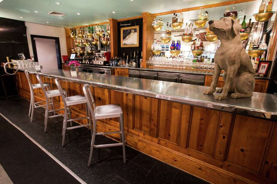 The bar at Ouisie's Table is shown on Tuesday, May 5, 2015, in Houston. ( Brett Coomer / Houston Chronicle ) Photo: Brett Coomer, Staff / © 2015 Houston Chronicle