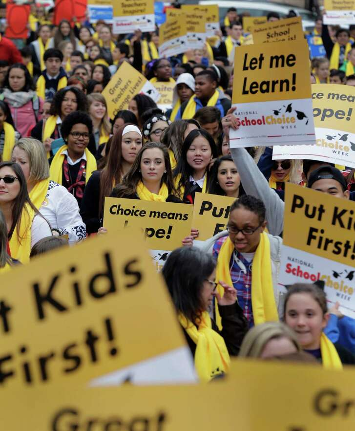 Students, teachers and supporters march on the grounds of the Texas Capitol last January  in Austin. School choice supporters called for expanding voucher programs and charter schools statewide.