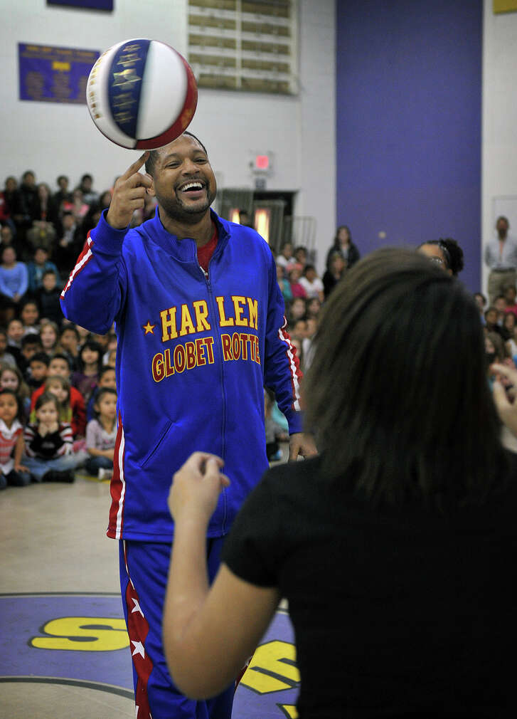Harlem Globetrotters' Handles Franklin performed ball-handling tricks during a visit to Zundy Elementary in Wichita Falls, Texas, on Jan. 22, 2015. Franklin also presented a program on bullying prevention. (AP Photo/Times Record News,  Torin Halsey)