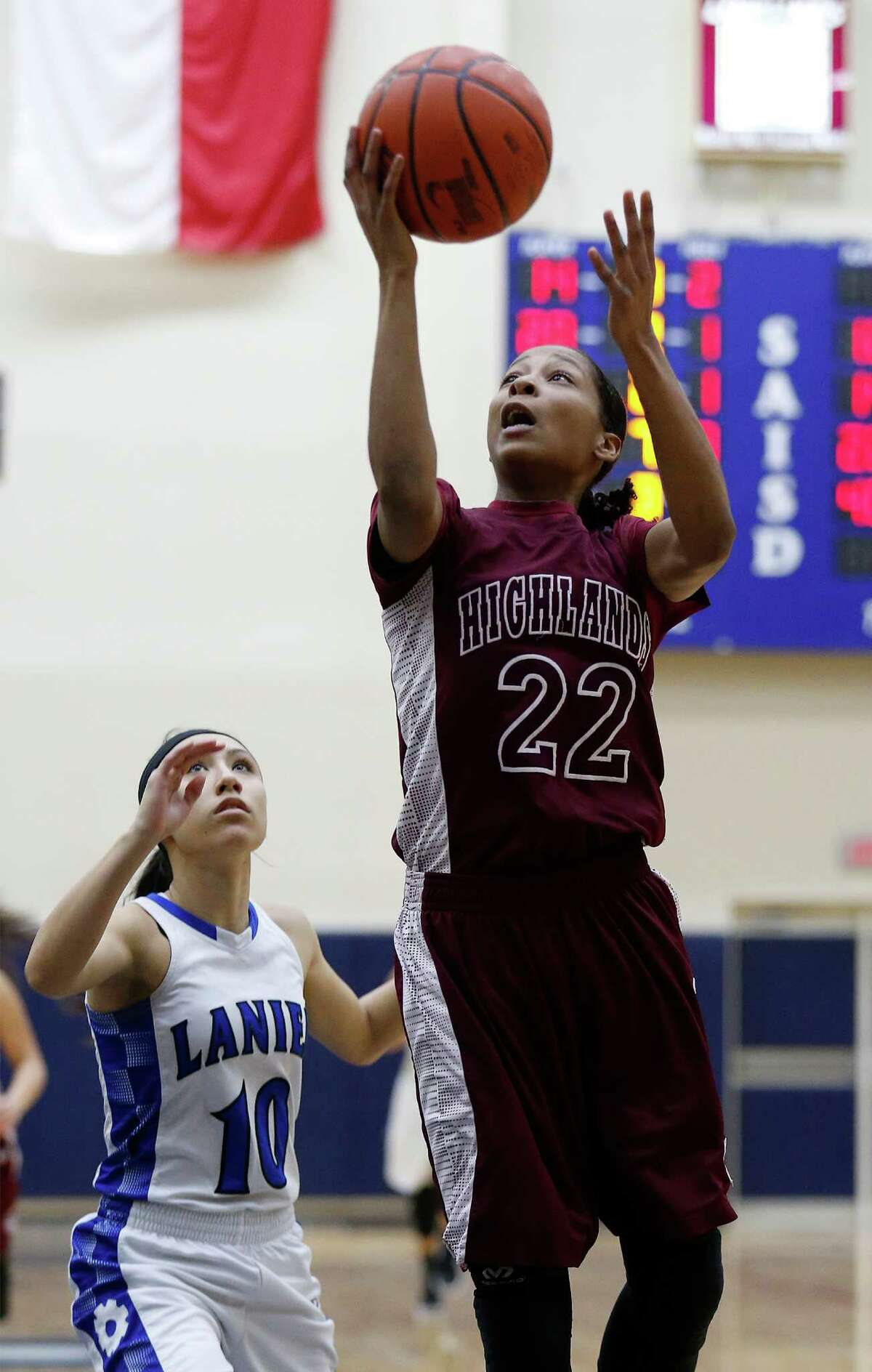 Highlands' Aaliyah Prince (22) attempts a layup against Lanier's Esmi Garza (10) in January action.