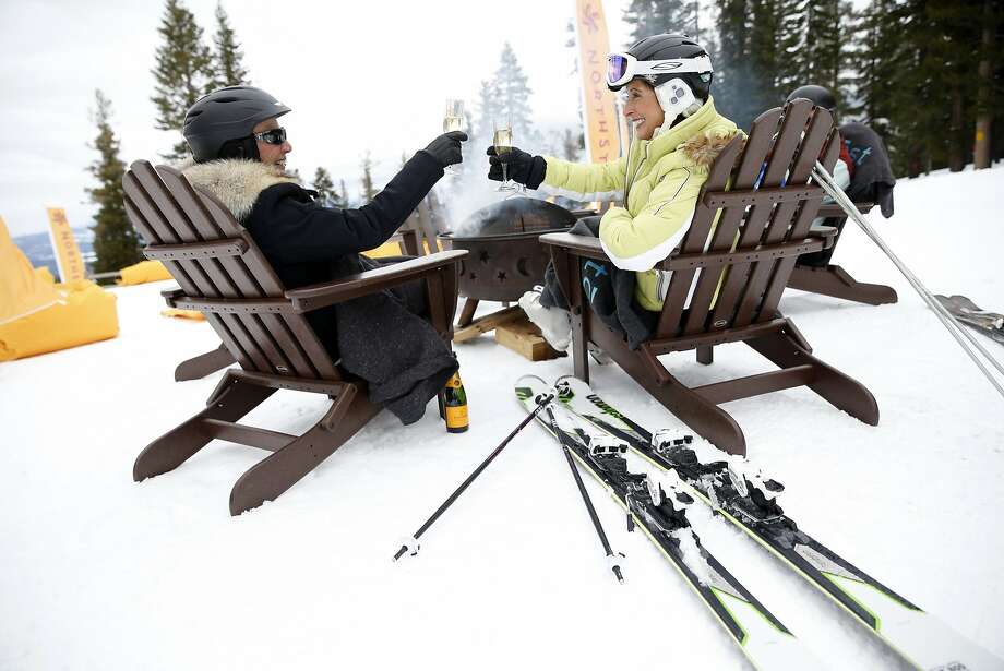 Annette Gellert (left) and Suzan Mason toast each other while taking a break from the slopes at Northstar California at Lake Tahoe. Photo: Scott Strazzante, The Chronicle