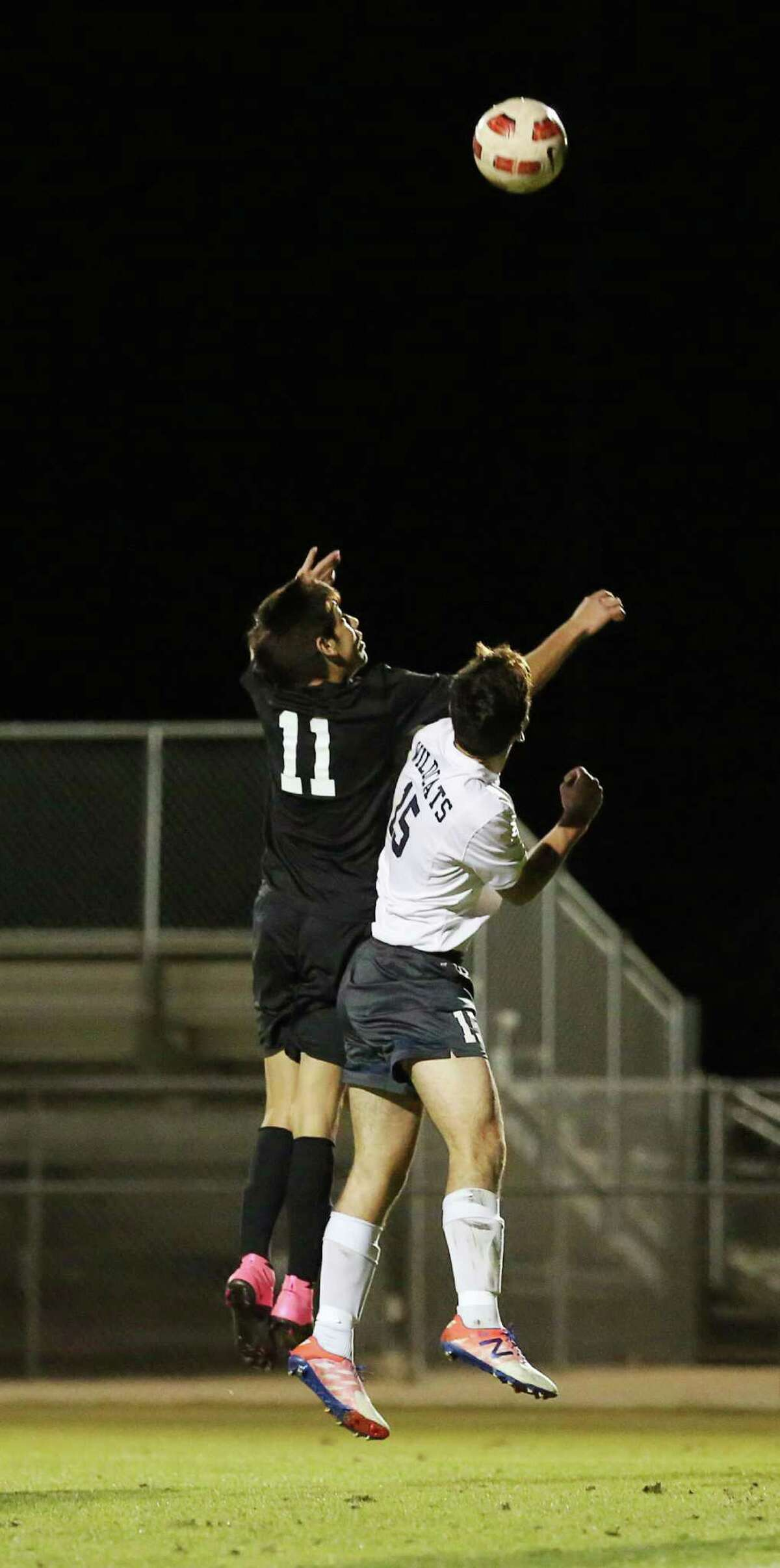 Spring Woods forward Jose Gonzales (11) goes for a header against Tomball Memorial defender Diego Urbano (15) during the first half of a soccer game between Spring Woods and Tomball Memorial Friday, Jan. 29, 2016, in Tomball.