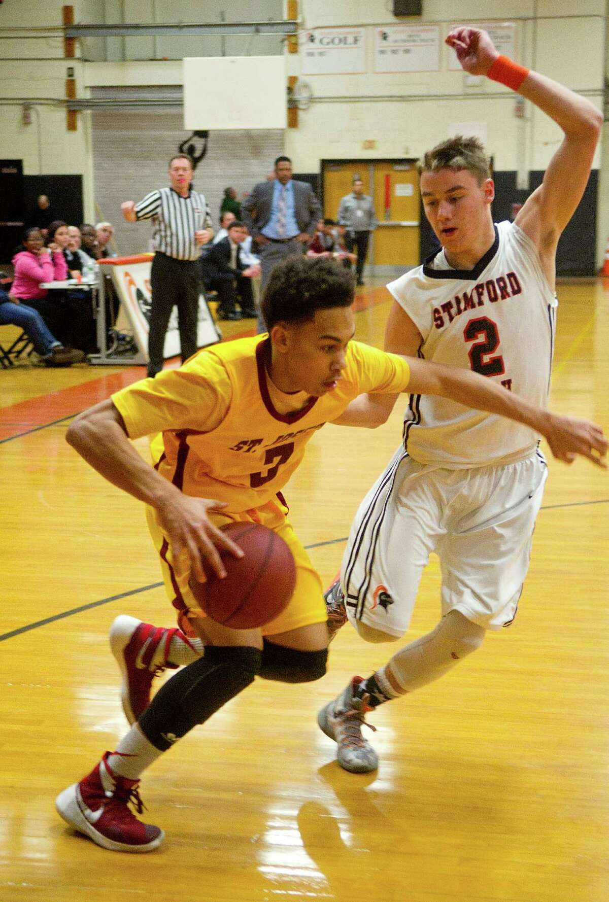 St. Joseph's Camren Menefee controls the ball during Friday's boys basketball game at Stamford High School.