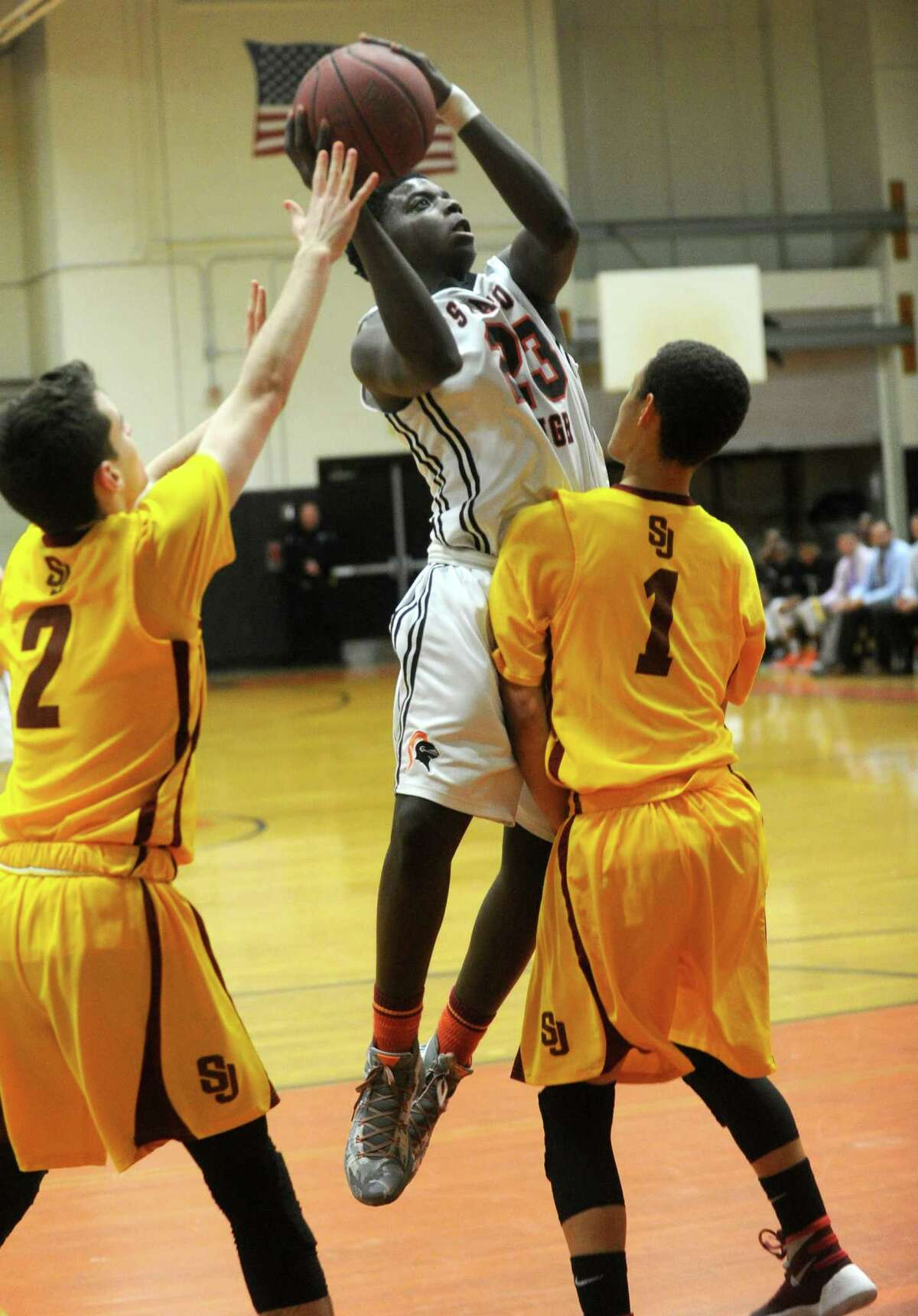 Stamford's Tevin St. John takes a shot during Friday's boys basketball game against St. Joseph at Stamford High School.