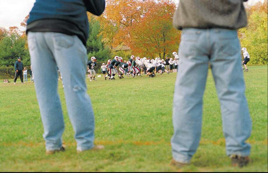 Parents cheer on their teams at the Western Middle School playing fields as the Generals play Wilton in youth football. Town officials are considering installing turf fields at the middle schools. Photo: Hearst Connecticut Media File Photo