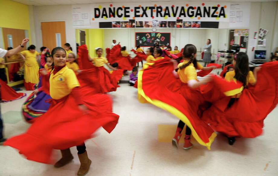 Second graders dance at HISD's Crockett Elementary School on Wednesday, Jan. 27, 2016, in Houston. Crockett Elementary School is one of 10 campuses that received the coveted magnet designation by the Houston school board in January 2015. Crockett has offered fine-arts classes for years, but has not received the extra funding and transportation for student transfers that come with the magnet label.  ( Karen Warren / Houston Chronicle ) Photo: Karen Warren, Staff / © 2015  Houston Chronicle