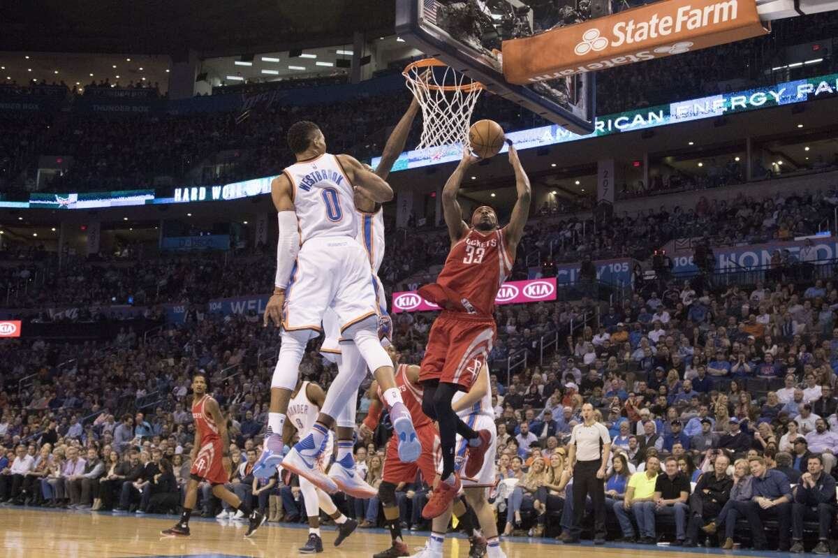 OKLAHOMA CITY, OK - JANUARY 29 : Kevin Durant #35 and Russell Westbrook #0 of the Oklahoma City Thunder fail to block a shot by Corey Brewer #33 of the Houston Rockets during the first quarter of a NBA game at the Chesapeake Energy Arena on January 29, 2016 in Oklahoma City, Oklahoma. NOTE TO USER: User expressly acknowledges and agrees that, by downloading and or using this photograph, User is consenting to the terms and conditions of the Getty Images License Agreement. (Photo by J Pat Carter/Getty Images)