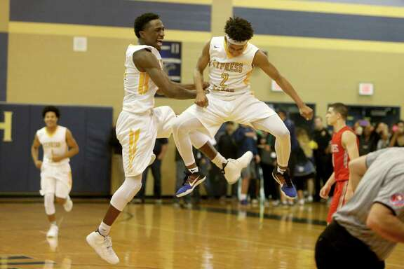 Miles Simms (2), of Cypress Ranch, and teammate Elish Benjamin (44) celebrate the Mustangs win over Cypress Lakes at the end of the fourth quarter at Cypress Ranch High Friday, Jan. 29, 2016, in Cypress, Texas. Cypress Ranch won 77-74.