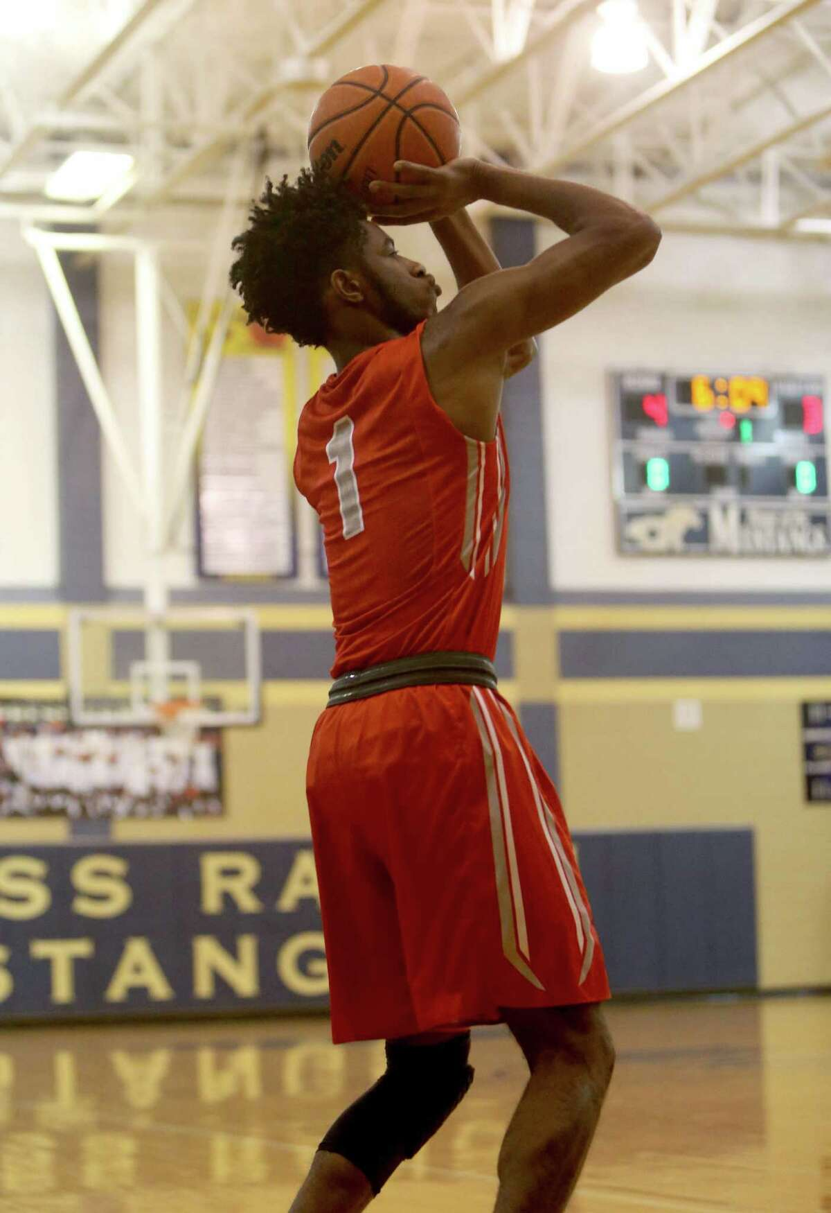Charles Williams (1), of Cypress Lakes, takes a shot against Cypress Ranch during the first quarter at Cypress Ranch High Friday, Jan. 29, 2016, in Cypress, Texas.