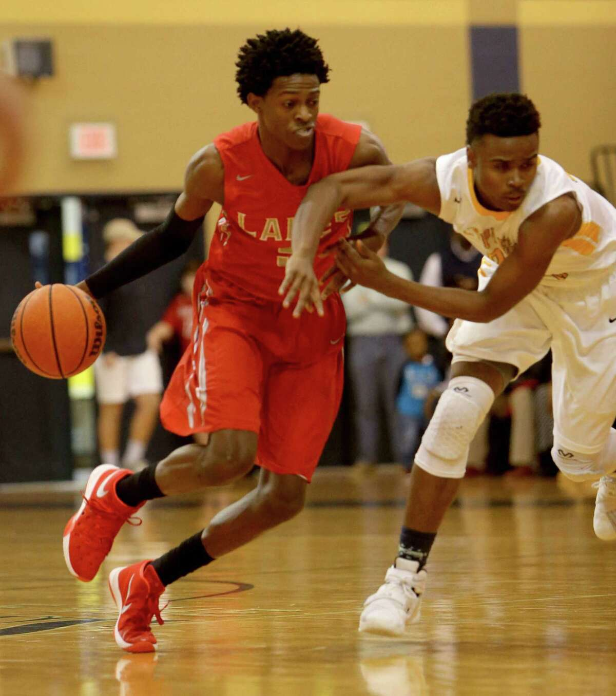 De'Aaron Fox (5), of Cypress Lakes, is guarded by Micheal Tate (23), of Cypress Ranch, during the first quarter at Cypress Ranch High Friday, Jan. 29, 2016, in Cypress, Texas.