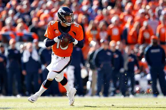 DENVER, CO - JANUARY 24:  Peyton Manning #18 of the Denver Broncos looks to pass in the first quarter against the New England Patriots in the AFC Championship game at Sports Authority Field at Mile High on January 24, 2016 in Denver, Colorado.  (Photo by Christian Petersen/Getty Images)