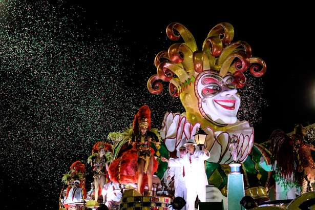 Revellers of Grande Rio Samba School, 3rd in the 2015 Rio's Carnival, perform during the Champions' Parade at the Sambadrome in Rio, Brazil, on February 21, 2015.  AFP PHOTO / YASUYOSHI CHIBA        (Photo credit should read YASUYOSHI CHIBA/AFP/Getty Images)